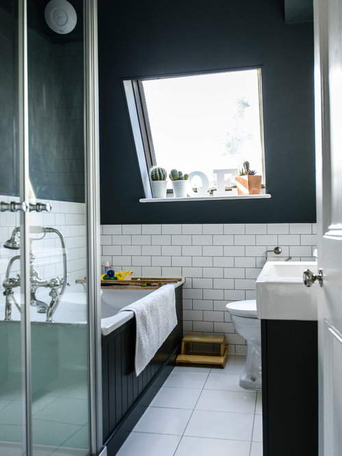 Good Transitional Drop In Bathtub Photo In London With An Integrated Sink, Black  Cabinets And