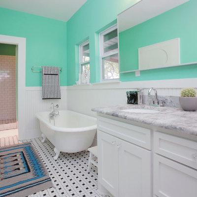 Claw-foot bathtub - eclectic multicolored floor claw-foot bathtub idea in Dallas with marble countertops