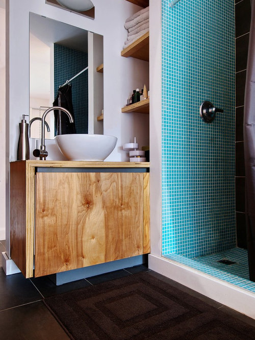 example of a minimalist black tile alcove shower design in toronto with a vessel sink and