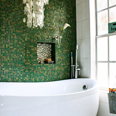 Eclectic freestanding bathtub photo in Tampa with green walls