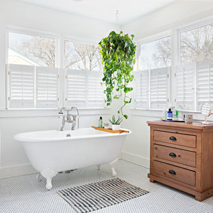 Claw-foot bathtub - shabby-chic style master mosaic tile floor and white floor claw-foot bathtub idea in Nashville with furniture-like cabinets, medium tone wood cabinets and white walls