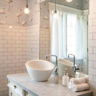 Inspiration for a mid-sized eclectic white tile and subway tile ceramic tile bathroom remodel in Cleveland with a vessel sink, furniture-like cabinets, distressed cabinets, marble countertops and multicolored walls