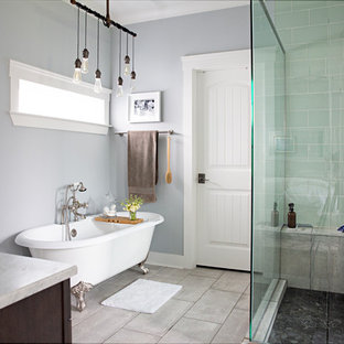 Corner shower - farmhouse master concrete floor and gray floor corner shower idea in Nashville with dark wood cabinets, gray walls, a vessel sink, a hinged shower door and gray countertops