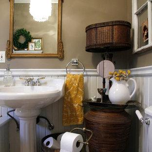 Idee per una stanza da bagno boho chic con lavabo a colonna