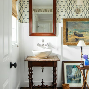 Inspiration for a beach style 3/4 dark wood floor and brown floor bathroom remodel in Boston with furniture-like cabinets, dark wood cabinets, a two-piece toilet, white walls, a vessel sink and wood countertops
