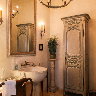 This is an example of a mediterranean bathroom with beige walls and a pedestal sink.