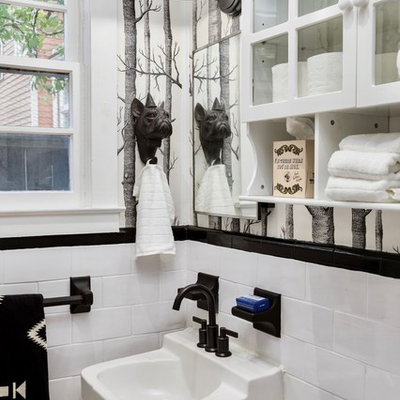 Example of an eclectic bathroom design in Atlanta with glass-front cabinets, yellow cabinets, multicolored walls and a wall-mount sink