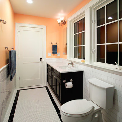 Bathroom - traditional white tile and subway tile white floor bathroom idea in DC Metro with an undermount sink, raised-panel cabinets, black cabinets and a two-piece toilet