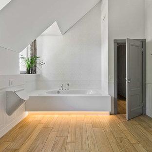 Large minimalist light wood floor and brown floor bathroom photo in Other