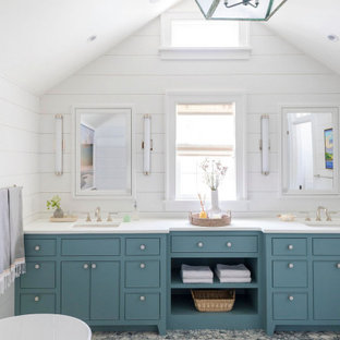 Photo of a beach style bathroom in Chicago with flat-panel cabinets, blue cabinets, white walls, an undermount sink, grey floor, white benchtops and a double vanity.