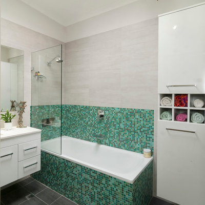 Inspiration for a mid-sized contemporary green tile and mosaic tile ceramic tile bathroom remodel in Canberra - Queanbeyan with flat-panel cabinets, white cabinets and quartz countertops