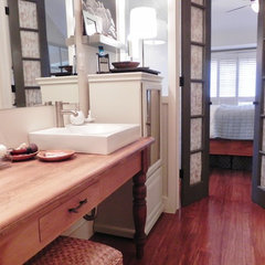 eclectic bathroom narrow bath, double sinks, antique table vanity, frosted glass, french doors