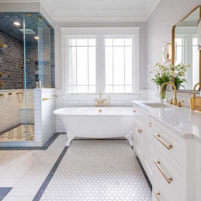 Bathroom - transitional master gray tile, white tile and subway tile mosaic tile floor and white floor bathroom idea in Nashville with shaker cabinets, white cabinets, gray walls, an undermount sink and white countertops