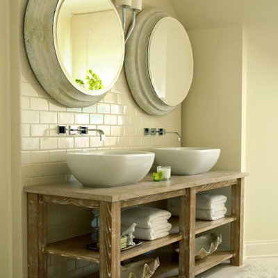 Example of a classic beige tile and subway tile bathroom design in Nashville with a vessel sink, open cabinets, wood countertops and beige countertops