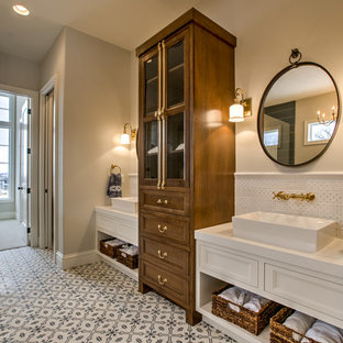 Inspiration for a large cottage master white tile and ceramic tile multicolored floor and cement tile floor bathroom remodel in Omaha with recessed-panel cabinets, white cabinets, gray walls, a vessel sink and white countertops