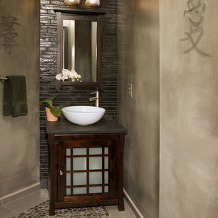 Small asian bathroom in Seattle with a vessel sink, furniture-like cabinets, dark wood cabinets, engineered quartz benchtops, brown tile, ceramic tile, beige walls and pebble tile floors.
