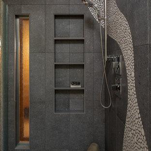 Foto de cuarto de baño actual, grande, con puertas de armario de madera oscura, bañera encastrada, sanitario de una pieza, baldosas y/o azulejos multicolor, suelo de baldosas tipo guijarro, lavabo encastrado, encimera de cemento, ducha con puerta con bisagras y encimeras grises
