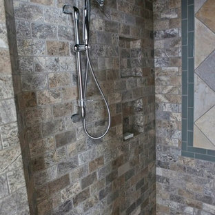 Inspiration for a rustic gray tile and stone tile doorless shower remodel in Milwaukee