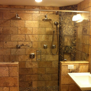 Double shower - large rustic master brown tile and stone tile double shower idea in Other with a two-piece toilet and gray walls