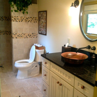 Doorless shower - mid-sized country 3/4 beige tile and ceramic tile ceramic tile doorless shower idea in Philadelphia with shaker cabinets, white cabinets, beige walls, a vessel sink and solid surface countertops