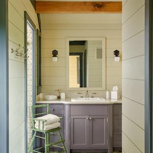 Imagen de cuarto de baño de estilo de casa de campo con armarios con paneles empotrados, puertas de armario violetas, paredes beige, suelo con mosaicos de baldosas, lavabo encastrado, suelo multicolor y encimeras beige
