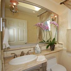 Farmhouse Bathroom by Jon Badeaux Construction, Inc.