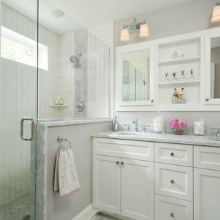 Inspiration for a medium sized traditional ensuite bathroom in Minneapolis with a submerged sink, shaker cabinets, white cabinets, stone tiles, grey walls, mosaic tile flooring, marble worktops, white tiles and an alcove shower.