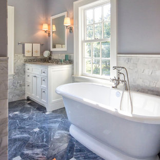 Example of a classic gray tile and marble tile blue floor and marble floor freestanding bathtub design in New York with beaded inset cabinets, white cabinets, marble countertops, gray countertops, an undermount sink and blue walls