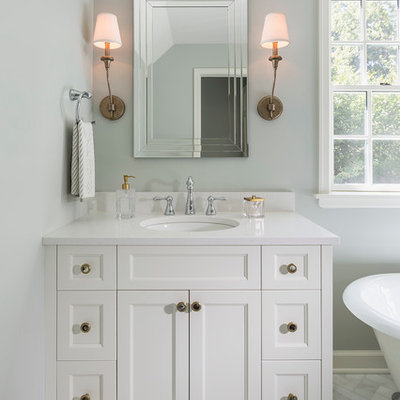 Inspiration for a large timeless master white tile and stone tile marble floor bathroom remodel in Minneapolis with recessed-panel cabinets, white cabinets, quartz countertops, gray walls and a console sink