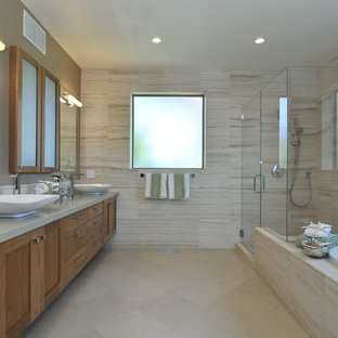 Inspiration for a transitional beige tile and travertine tile ceramic tile bathroom remodel in San Francisco with a vessel sink, medium tone wood cabinets, quartz countertops, beige walls and shaker cabinets