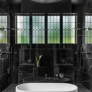 Esempio di una stanza da bagno padronale mediterranea con vasca freestanding, doccia doppia, piastrelle nere, pareti nere e pavimento nero