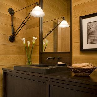 シャーロットのトランジショナルスタイルのおしゃれな浴室 (落し込みパネル扉のキャビネット、濃色木目調キャビネット、ベージュのタイル、ベージュの壁、一体型シンク、コンクリートの洗面台) の写真