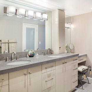 Expansive contemporary bathroom in Miami with flat-panel cabinets, beige cabinets, beige walls, ceramic floors, an undermount sink, terrazzo benchtops, grey floor and grey benchtops.