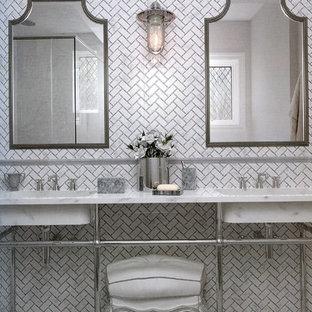 Inspiration pour une salle de bain principale design de taille moyenne avec un carrelage blanc, un carrelage de pierre, une douche d'angle, un mur blanc, sol en stratifié, un plan vasque, un plan de toilette en marbre, un sol gris et une cabine de douche à porte battante.