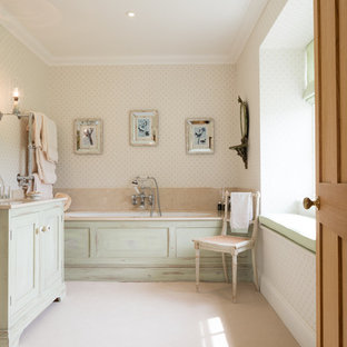 Inspiration for a traditional ensuite bathroom in Wiltshire with shaker cabinets, green cabinets, an alcove bath, beige walls, beige floors and beige worktops.