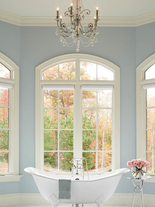 example of a classic white tile claw foot bathtub design in raleigh with a drop