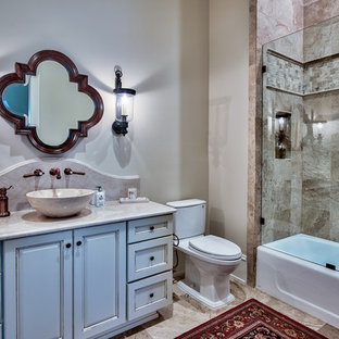 Tuscan bathroom photo in Miami with raised-panel cabinets, white cabinets, gray walls and a vessel sink