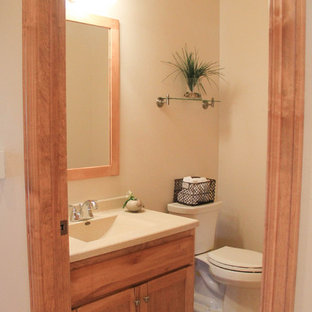 Example of a small classic 3/4 ceramic floor bathroom design in Other with flat-panel cabinets, light wood cabinets, a one-piece toilet, beige walls, an integrated sink and laminate countertops