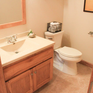 Inspiration for a small timeless 3/4 ceramic floor bathroom remodel in Other with flat-panel cabinets, light wood cabinets, a one-piece toilet, beige walls, an integrated sink and laminate countertops