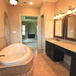 Ispirazione per una stanza da bagno padronale chic con ante in stile shaker, ante in legno bruno, vasca da incasso, doccia doppia, piastrelle beige, piastrelle in ceramica, pareti beige, pavimento con piastrelle in ceramica, lavabo sottopiano e top in granito