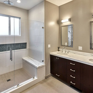 Alcove shower - mid-sized transitional master white tile and mirror tile ceramic floor and beige floor alcove shower idea in San Francisco with shaker cabinets, black cabinets, a one-piece toilet, beige walls, an undermount sink, marble countertops and a hinged shower door