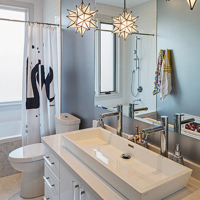 Bathroom - contemporary white tile bathroom idea in Toronto with a vessel sink, flat-panel cabinets and white cabinets