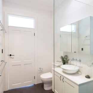 Inspiration for a mid-sized transitional 3/4 bathroom in Sydney with shaker cabinets, white cabinets, a freestanding tub, an open shower, white tile, ceramic tile, white walls, limestone floors, quartzite benchtops, grey floor, an open shower, white benchtops, a two-piece toilet and a vessel sink.