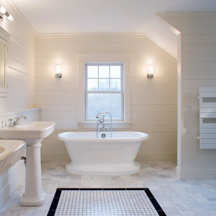 Mid-sized country master marble floor and white floor freestanding bathtub photo in Providence with a pedestal sink and white walls