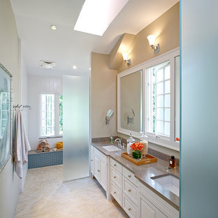 This is an example of a traditional bathroom in DC Metro with limestone benchtops and a curbless shower.
