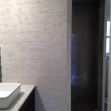 Modern Bathroom by Kourasanit Nola Inc