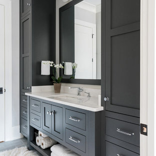 Design ideas for a mid-sized transitional master bathroom in Atlanta with shaker cabinets, an alcove shower, white tile, subway tile, grey walls, an undermount sink, engineered quartz benchtops, a hinged shower door, grey cabinets, laminate floors and grey floor.