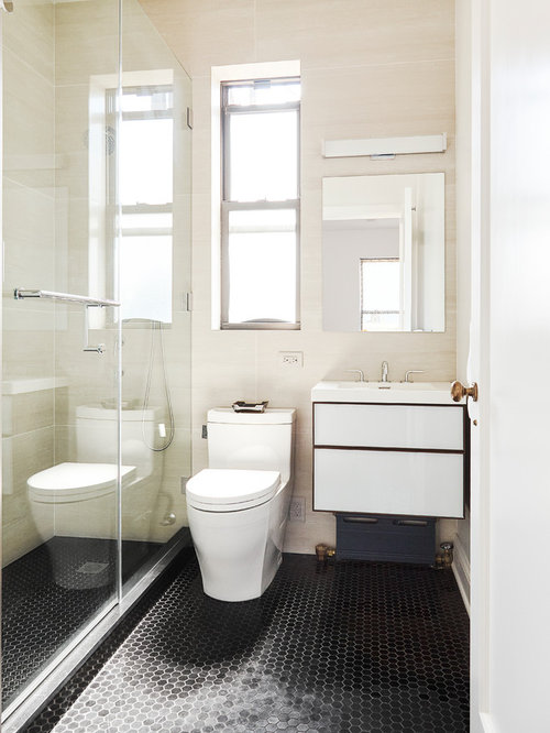 Example Of A Small Minimalist Master Beige Tile And Porcelain Marble Floor Black