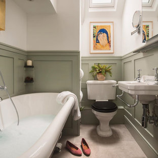 Photo of a medium sized traditional shower room bathroom in Cornwall with a freestanding bath, a two-piece toilet, green walls, a wall-mounted sink, grey floors, a single sink and wainscoting.