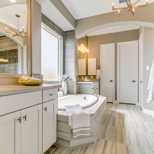 Bathroom - traditional master gray tile and ceramic tile beige floor and ceramic floor bathroom idea in Houston with white cabinets, gray walls, an undermount sink, a hinged shower door, beige countertops and shaker cabinets